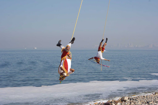 "The Voladores de Papantla (flyers of Papantla, also sometimes known as hombres pajaro, or ""bird men"") on the Melacon in Puerto Vallarta, Mexico."