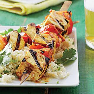 Curry Tofu-and-Bell Pepper Skewers with Sticky Coconut Couscous.