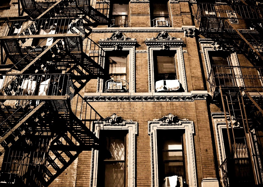 by Leann Shamash - Buildings & Architecture Other Exteriors ( fire escapes, building facade, brick, lines and points, new york city, shadows )