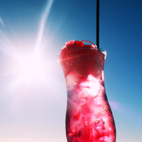 Cocktail In The Sun by Leanne Oosthuizen - Food & Drink Alcohol & Drinks ( cool, cherry, drink, lemonade, cocktail, pink, sun )
