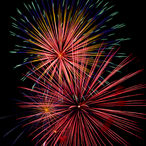 Brilliant Booms by Kenneth Keifer - Public Holidays July 4th ( blasts, spectacular, booming, new year, colorful, festivities, sky, sparkling, exploding, labor day, dark, july, festival, gold, fire works, sparks, 4th, celebrate, light, darkness, evening, bang, extravaganza, orange, purple, explosions, green, hues, pyrotechnics, fair, fourth, dazzling, red, color, blue, patriotic, of july, fireworks, night, boom, celebration, new years eve, chinese new year, independence day, stunning, new years )