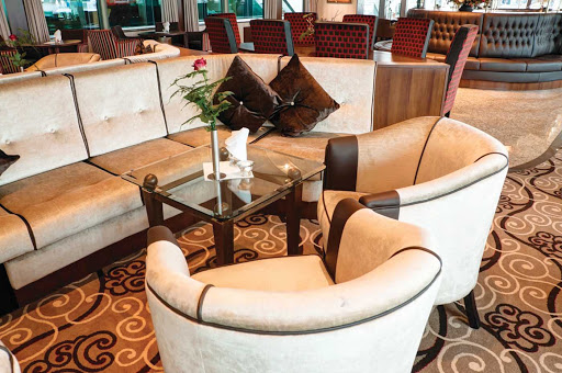 Tauck-InspirationClass-Lounge - The lounge aboard Tauck's new river cruise ships Inspire and Savor. At 443 feet, the ships are the same length as Viking River Cruises' Longships but carry 130 guests, compared to Viking's 190.