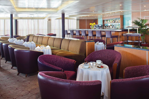 Unwind after a day of sightseeing in the Gallieo Lounge on deck 11 of Seven Seas Navigator.