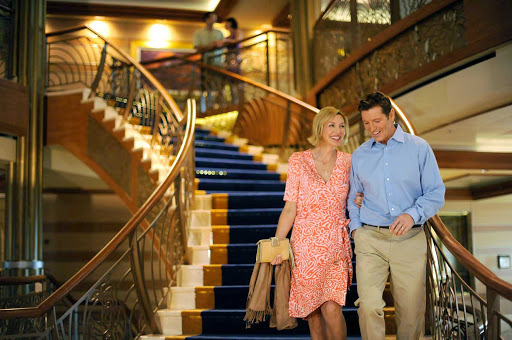 Disney-Dream-couple-on-stairs - A couple on the large stairway on Disney Dream.