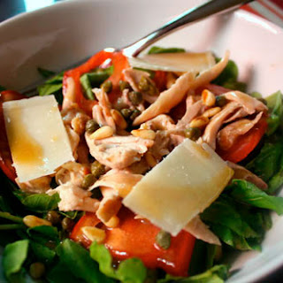 Warm Chicken Salad with Arugula, Capers, and Pine Nuts.