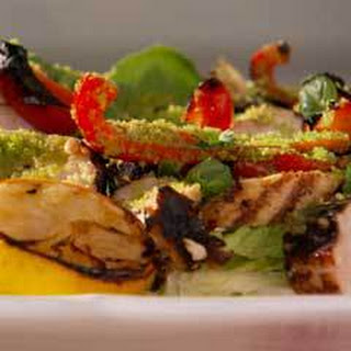Grilled Italian Chicken Salad With Romaine Spears And Roasted Red Peppers.