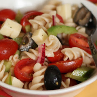 Tangy Pasta Salad with Tomatoes, Peppers and Olives.