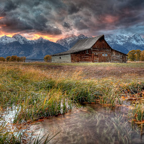Teton Nightfire by Ryan Smith - Buildings & Architecture Decaying & Abandoned ( night fire, sunset, mormon row, tetons, moulton barn, storm, stormy, weather )