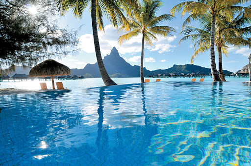 Reflect on this: The infinity pool at the InterContinental Bora Bora Resort, with Mount Otemanu in the background, is part of your Paul Gauguin cruise.