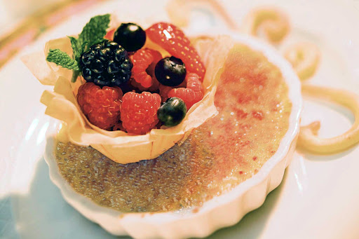 Norwegian-Cruise-Line-dining-Creme-Brulee - Leave room for dessert, like crème brûlée with a fruit topping, during your sailing aboard Norwegian Cruise Line.