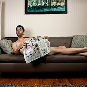 You said make yourself at home by Joe Eddy - People Portraits of Men ( couch, dude, naked, comfort, joke, newspaper )