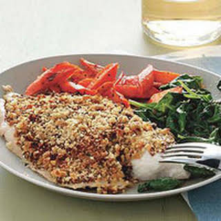 Nut-Crusted Tilapia with Spinach and Roasted Carrots.