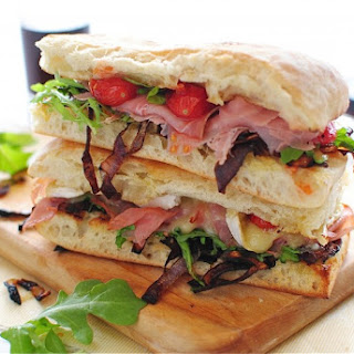 Toasted Ciabatta Sandwiches with Caramelized Onions, Arugula, Prosciutto and Brie
