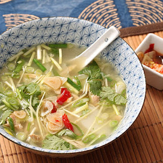 Easy Chicken and Ginger Soup With Rice Cakes, Chives, and Quick-Pickled Garlic