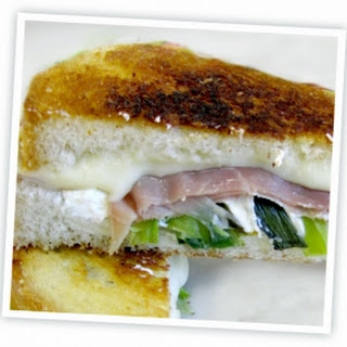 Grilled Rustic Goat Cheese & Havarti with Charred Onions & Prosciutto.