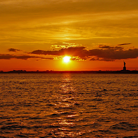 CALLING US IN by Kendall Eutemey - Landscapes Sunsets & Sunrises ( statute of liberty, orange, kendall eutemey, waterscape, sunset, seascape, new york city,  )