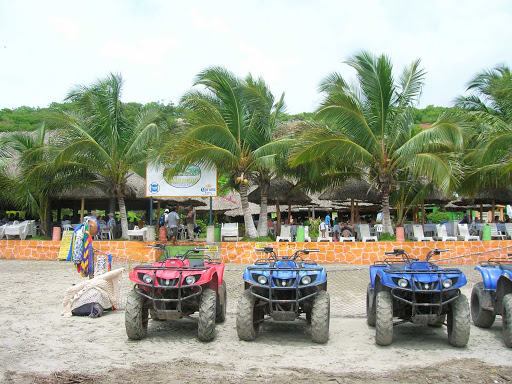 atv-Mazatlan-Mexico - All-terrain vehicles ready to roll on the beach at Mazatlan, Mexico.
