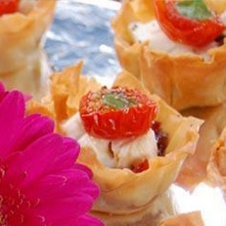 Mini Filo Tarts with Caramelised Red Onion, Goats Cheese and Tomato Recipe
