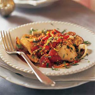 Baked Fish with Roasted Potatoes, Tomatoes, and Salmoriglio Sauce.