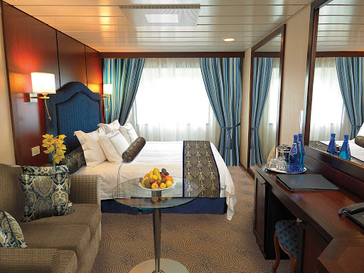 Oceania-C-Deluxe-Ocean-View-Stateroom - The C Level Deluxe Ocean View staterooms on Oceania Regatta contain custom-designed furnishings, queen or two twin bed accommodations, spacious seating area, vanity desk and breakfast table. At 165 square feet, they're located on decks 4,6 and 7.