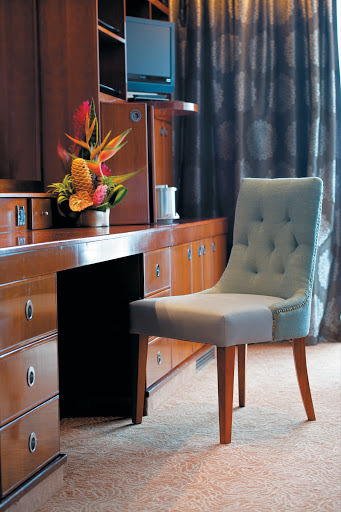 Tasteful appointments inside the Grand Suite on the Paul Gauguin.