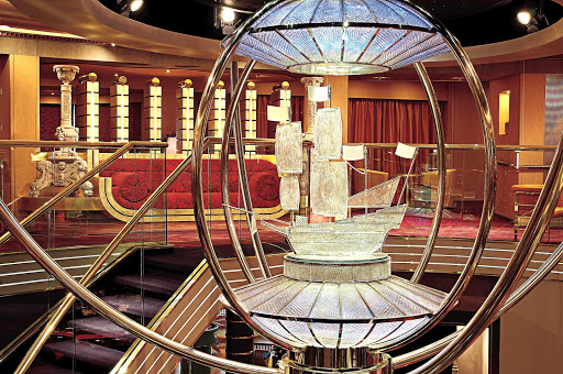 Holland-America-Westerdam-Atrium - The theme of Westerdam's atrium and surrounding art is Dutch heritage in the new world. Artworks aboard this Holland America Line ship include paintings of historic Dutch ships and an  original Andy Warhol portrait.
