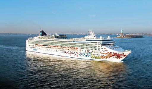 Norwegian-Gem-Aerial-NY-Statue-of-Liberty - Norwegian Gem sails past the Statue of Liberty into New York Harbor.