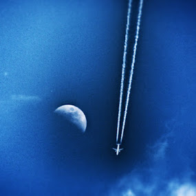 Plane Plunges Blue Sky Next to the Moon by Nat Bolfan-Stosic - Transportation Airplanes ( hill, moon, blue sky, plane, plungs,  )
