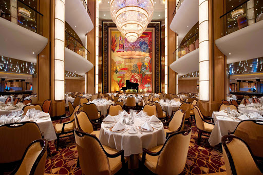 Adagio, the main dining room on Allure of the Seas, spans decks 3, 4 and 5 with a seating capacity of 3,056 guests. It features a 1920s art deco décor and is open for breakfast, lunch and dinner. Round tables seat six to 12 guests.