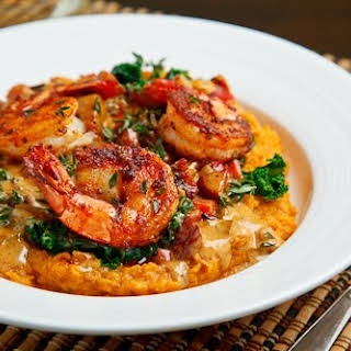 Blackened Shrimp on Kale and Mashed Sweet Potatoes with Andouille Cream.