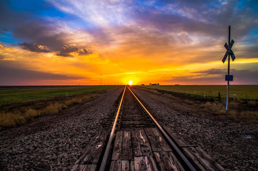 Sunset on Tracks by Brandon Green - Landscapes Sunsets & Sunrises ( clouds, train tracks, sunset, railroad, texas, weather, sun )