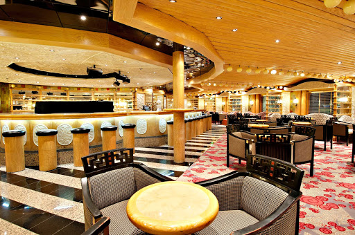 Carnival-Pride-Ivory-Piano-Bar - Sing along to your favorite tunes at the Ivory Piano Bar, on Carnival Pride's deck 3.