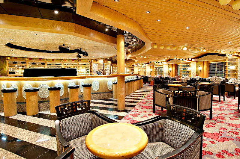 Sing along to your favorite tunes at the Ivory Piano Bar, on Carnival Pride's deck 3.
