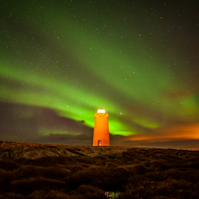 Northernlights above lighthouse by Sigurbjörn Agust Ragnarsson - Landscapes Starscapes ( icelandic, europe, green, northern lights, aurora borealis, lighthouse, yellow, holmsbergsviti, keflavik, iceland, clouts, stars, night, magnetic, light )