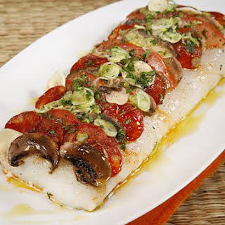 Pizza of Roasted Cod Spiked with Chorizo, Tomatoes, and Mushrooms.