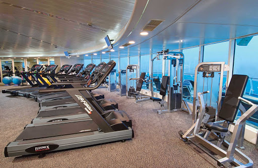 Enchantment-of-the-Seas-ShipShape - Work up a sweat with a view of the sea at Enchantment of the Seas' ShipShape Fitness Center.