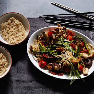 Spicy Asian mushroom stir-fry with Chinese sausage and tomato.
