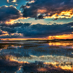 The colors of a cold front by Deborah Felmey - Landscapes Sunsets & Sunrises ( water, bay, colors, sunset, landscape, storm,  )