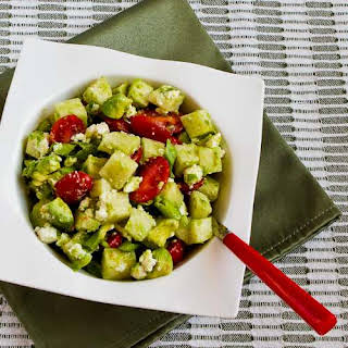 Cross-Cultural Salad Recipe with Tomato, Avocado, Jicama, Lime, and Feta.