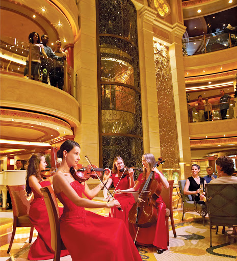 Princess-Cruises-piazza-style-atrium - Don't be surprised if a symphony breaks out on your  Princess cruise. The  piazza-style atrium features live entertainment, spiral staircases and dining and cocktail lounge options.