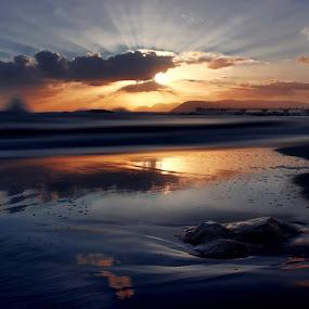 Double Sunset by Paolo Lazzarotti - Landscapes Sunsets & Sunrises ( orange and blue, sunset, stone, dark clouds, beach, seascape, sun rays, reflex,  )