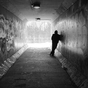 Taking Shelter by Joanne Hughes-Brown - Black & White Portraits & People ( amatuer, black and white, silhouette, graffiti, people, tunnel,  )