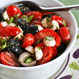 Tomato, Olive, and Mozzarella Salad with Basil Vinaigrette.