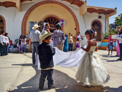 Two kids take part in a wedding at the Plaza Sayulita, Mexico.