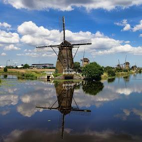 Kinderdijk by Stefano Landenna - Buildings & Architecture Public & Historical ( clouds, canals, rotterdam, kinderdijk, holland, reflections, windmill )