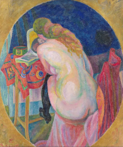 Nude woman reading