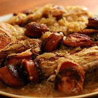 Stuffed Pork Chops with Kielbasa and Sauerkraut.