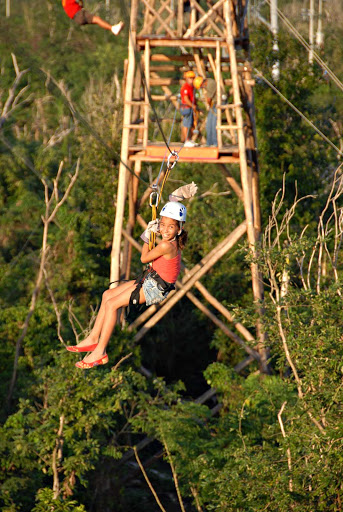 zipline-girl-Cozumel - Zip lining on Cozumel is a thrill ride for all ages.