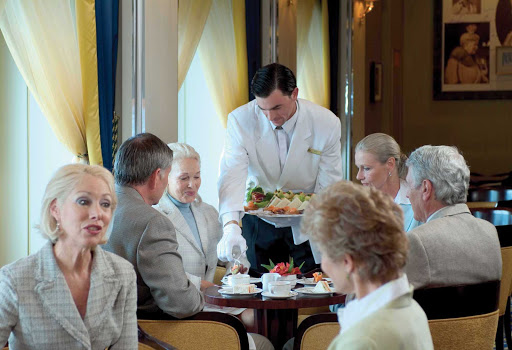Cunard-Queen-Mary-2-afternoon-tea - Enjoy being served by white-gloved waiters during afternoon tea while listening to a live orchestra in the Queens Room aboard Queen Mary 2.