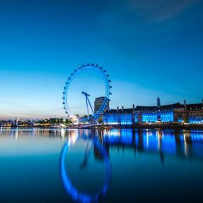 Sunrise on the Thames by Neil Jayaratne - Landscapes Sunsets & Sunrises ( exposure, water, reflection, uk, still, long, lights, londoneye, thames, london, blue, southbank, sunrise, nikon, eye, river,  )